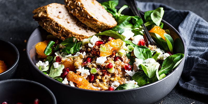 Buckwheat salad on black table and black background