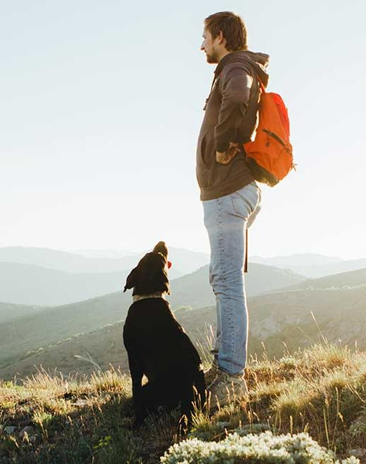 man outdoors with dog