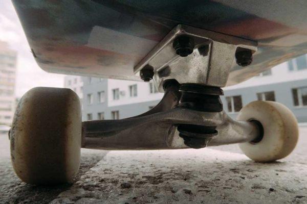 underside of skateboard on pavement